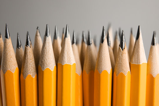 Sharp graphite pencils on grey background, closeup