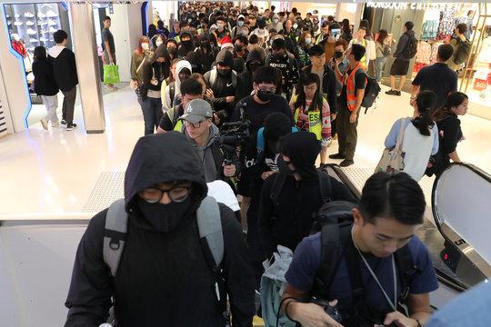 Hong Kong protesters attend a Christmas Day rally in Sha Tin shopping mall in Hong Kong