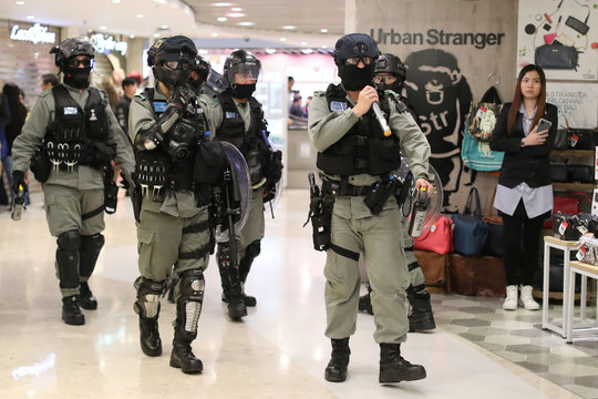 Riot police confront Hong Kong protesters during a Christmas Day rally in Sha Tin shopping mall in Hong Kong