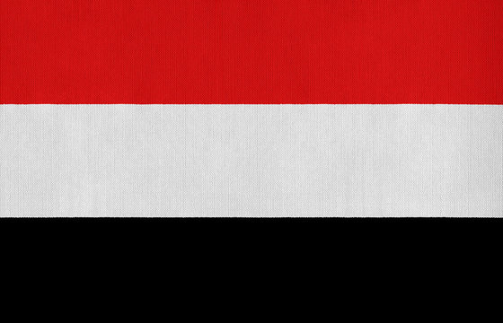 National flag of Yemen on a cotton texture background