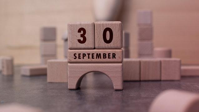 September 30 written with wooden blocks