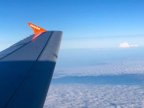 A view of an Eayjet aircraft wing flying above the clouds on July 12, 2018 somewhere over the North Sea UK