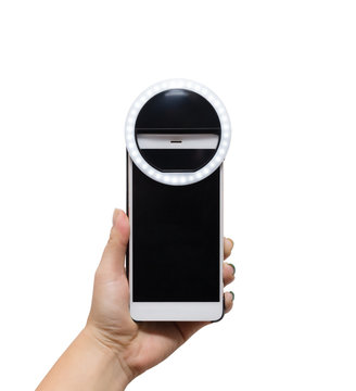 hand holding smarthone with selfie ring lamp
