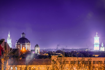 Foto auf Leinwand Violett Night Lviv old city architecture in the Christmas
