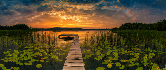 Tuinposter Waterlelies Panorama of beautiful sunrise over lake