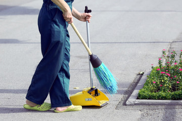 the janitor sweeping broom street