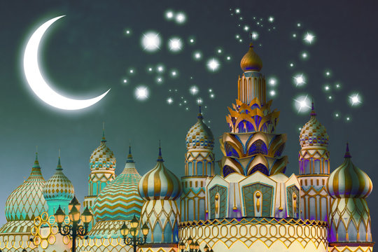 Fantasy world of arabian nights in the Global village in Dubai, United Arab Emirates at a starry night with a glowing crescent on the sky.