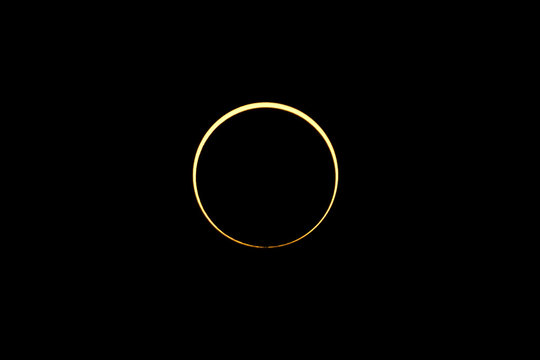 The moon passes between the sun and the earth during an annular solar eclipse in Singapore