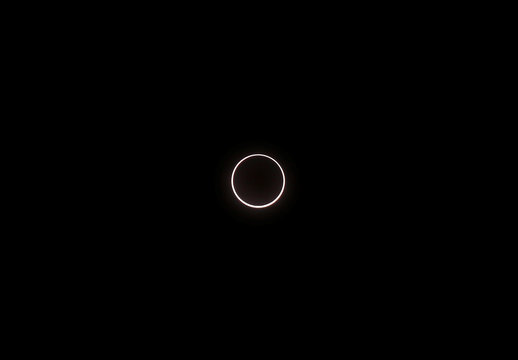 The moon passes between the sun and the earth during an annular solar eclipse over the skies of Cheruvathur