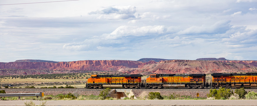 Freight  BNSF train, canyon de Chelly area, banner, sunny spring day in Chinle, Arizona, USA.