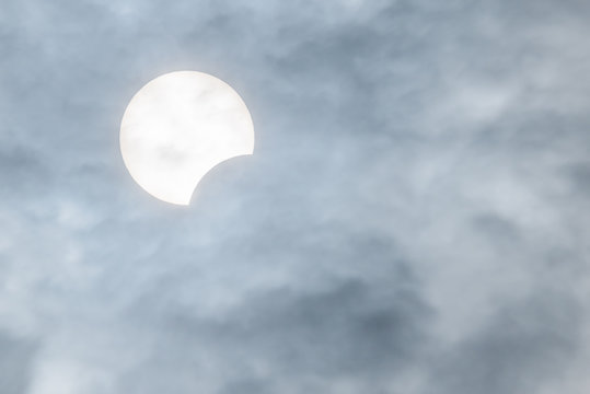 Partial sun eclipse behind clouds on Dec 26, 2019 in Chengdu, Sichuan province, China