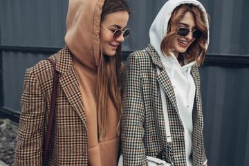 Portrait of Two Fashion Girls, Best Friends Outdoors, Wearing Stylish Jacket