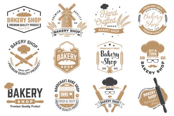 Set of Bakery shop badge. Vector Concept for badge, shirt, label, print, stamp, tee. Design with windmill, rolling pin, dough, wheat ears silhouette. For restaurant identity objects, packaging, menu Fototapete