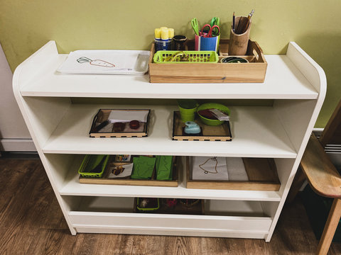 racks with work in a montessori class