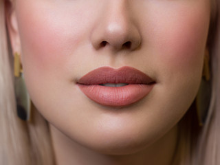 Sexual full lips. Natural gloss of lips and woman's skin. The mouth is closed. Increase in lips, cosmetology. Natural lips. Great summer mood with open eyes. fashion jewelry. Pink lip gloss Wall mural