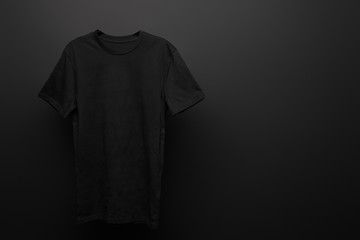 blank basic black t-shirt on black background Wall mural