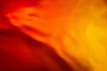 Beautiful abstract background from mixed water and oil in orange color