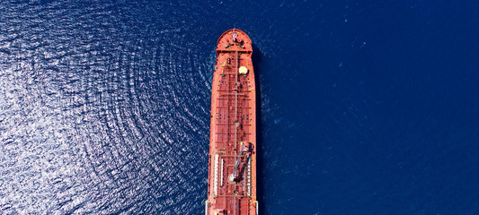 Canvas Prints Ship Aerial drone ultra wide photo of industrial petrochemical oil and gas fuel tanker ship cruising Mediterranean deep blue sea