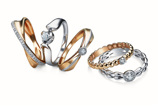 group of diamond rings stacked on white background, white gold, yellow gold, included clipping path. extreme close up.