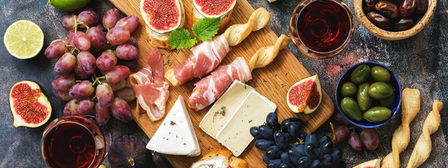 Door stickers Wine Italian antipasti wine snacks set. Prosciutto,red wine, cheese, olives, grapes, figs and cheese. Top view, banner.