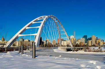 Beautiful winter view of Walterdale suspension bridge and the downtown skyline in Edmonton, Alberta, Canada.