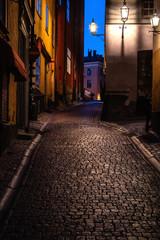 Türaufkleber Stockholm Narrow cobblestone street in the central part of Gamla Stan. Stockholm, Sweden. Evening photo. Selective focus.