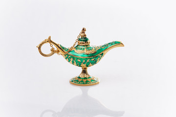 Aladdin's magic genie lamp isolated on white. Aladdin's lamp is green on a white background.