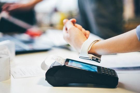 Customer using smart watch to pay.