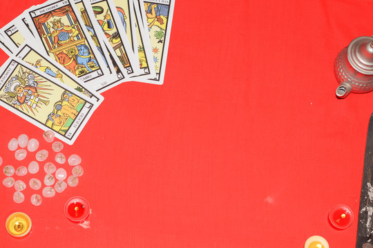 Assortment of Tarot inspired cards on a red background
