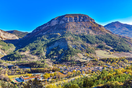 Remuzat village in Baronnies area in Southern France. Des Gravieres mountain is at background. Drome, Auvergne-Rhone-Alpes region.
