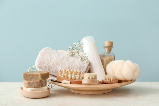 Set of bath accessories on white table