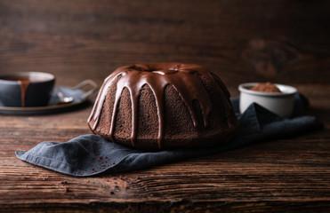 Delicious dessert, dark chocolate bundt cake topped with ganache glaze