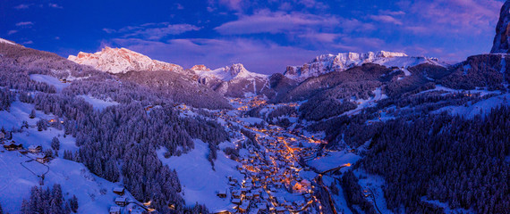 Fotobehang Alpen Aerial night view of the Val Gardena ski resort mountain village in Dolomites, Italy, Beautiful cozy village in winter time during Christmas.