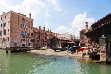 Foto op Canvas Gondolas Last gondolas repairman. Venice landmark, Italy