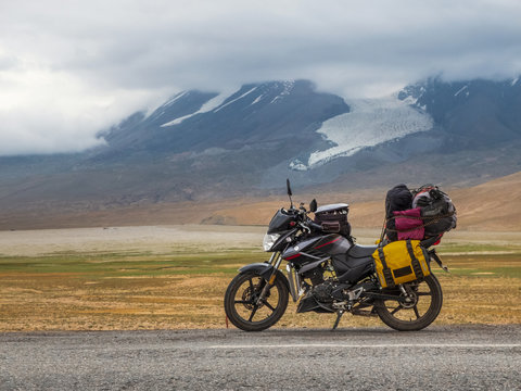 Traveling motorcycle with luggage in stormy weather