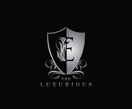 Luxury Guard E Letter Logo Icon. Silver E With Classy Shield Shape design perfect for fashion, Jewelry, Beauty Salon, Cosmetics, Spa, Hotel and Restaurant Logo.