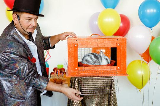 Magician, an illusionist shows tricks.