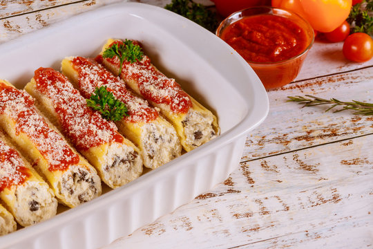 Cannelloni pasta stuffed with ricotta, mushrooms and tomato sauce.