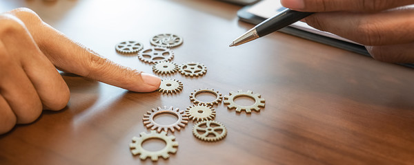 Business Solutions for Success and Strategy. Business team brainstorming and connecting the gears with a puzzle. Fulfill and fix the problem of incomplete teamwork.