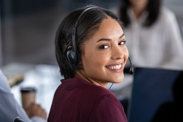 Woman wearing headset in call center Fototapete