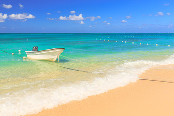 Small boat on the beach of Montego Bay in Jamaica