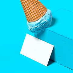 Blue Ice Cream in Wafer Cone On Blue Pedestal Near Blank Business Card. Confectionery Presentation. 3d rendering.