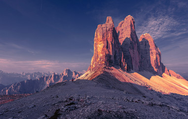 Fotomurales - Awesome alpine highlands during sunrise. Amasing nature landscape. Tre Cime di Laveredo, three spectacular mountain peaks with colorful sky,  Dolomites Alps, South Tyrol, Italy. Picture of wild area