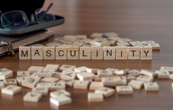masculinity the word or concept represented by wooden letter tiles