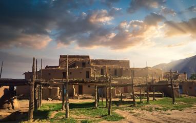 Taos Pueblo Illuminated by the Morning Sun over the Sangre de Cristo Mountains in New Mexico