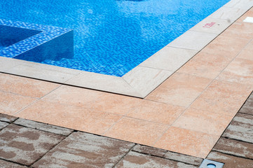Detail of outdoor swimming pool filled with water closeup