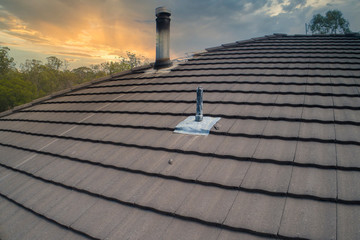 Drone asset inspection of a brown terracotta tile roof