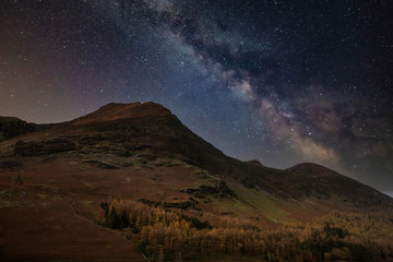 Photo sur cadre textile Marron chocolat Stunning majestic digital composite landscape of Milky Way over Buttermere in Lake District