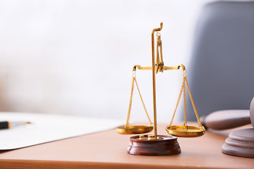 Scales of justice on lawyer's workplace