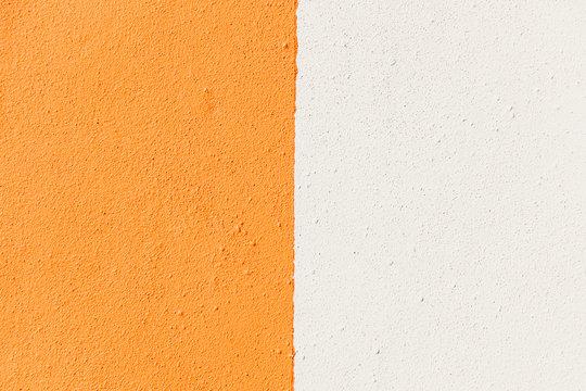 White  orange split color concrete background backdrop texture
